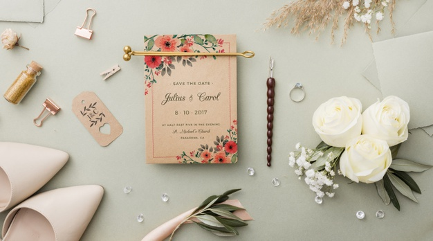 flat-lay-composition-wedding-elements-with-card-mock-up_23-2148502021